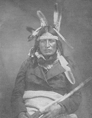Black and white photograph of the Ho-Chunk leader Baptiste Lasallier wearing a mix of American Indian and Euro-American clothing, c.1855.