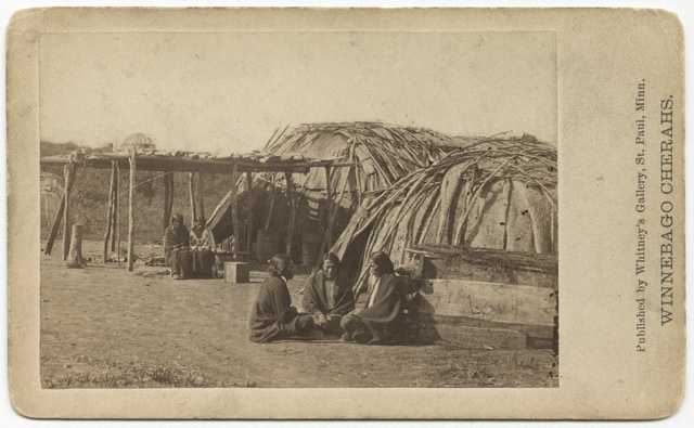 Black-and-white photograph of a Ho-Chunk (Winnebago) encampment taken by Whitney's Gallery, c.1865.