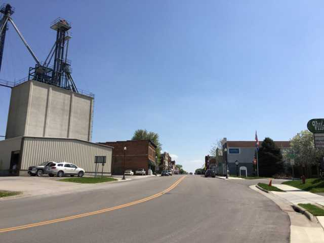 Photograph of tntrance to Harmony's Main Street, grain elevator