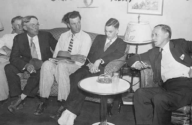 photograph of Farmer's Holiday Association representatives with Harry L. Hopkins