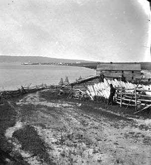 Black and white photograph of a view of La Pointe with Bayfield in the distance, 1875.