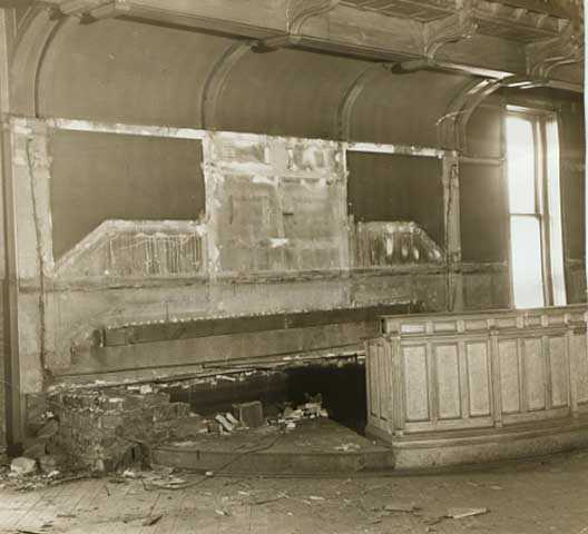 Black and white photograph of the Supreme Court chamber in the second capitol building, partially dismantled prior to building demolition, 1937. Photographed by the Minneapolis Tribune.