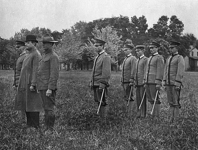 Black and white photograph of Governor Joseph A. A. Burnquist with a military group, c.1916.