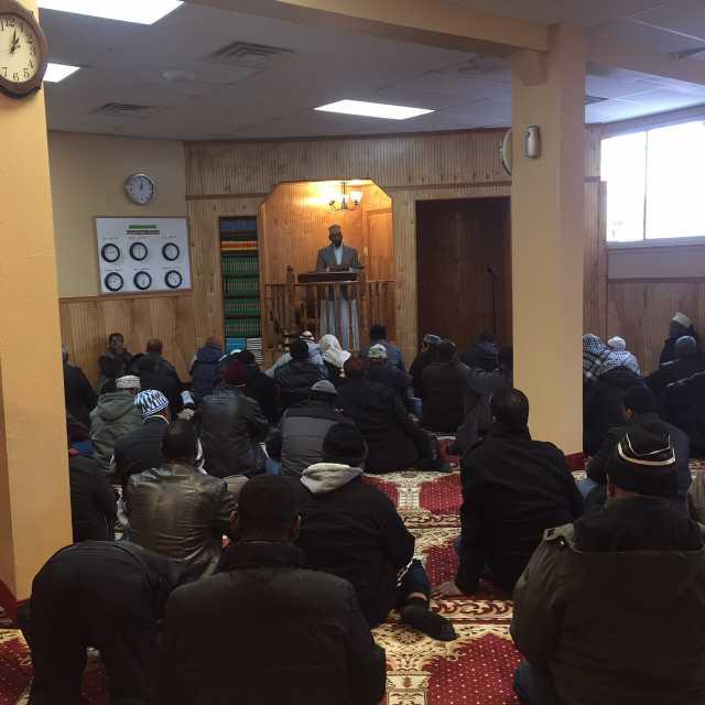 Color image of Friday prayer at Dar Al-Hijrah Mosque, 2015.