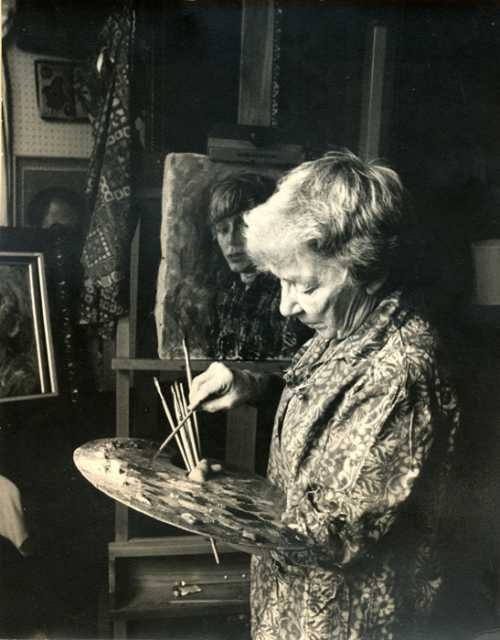 Gene Ritchie Monahan working in her studio