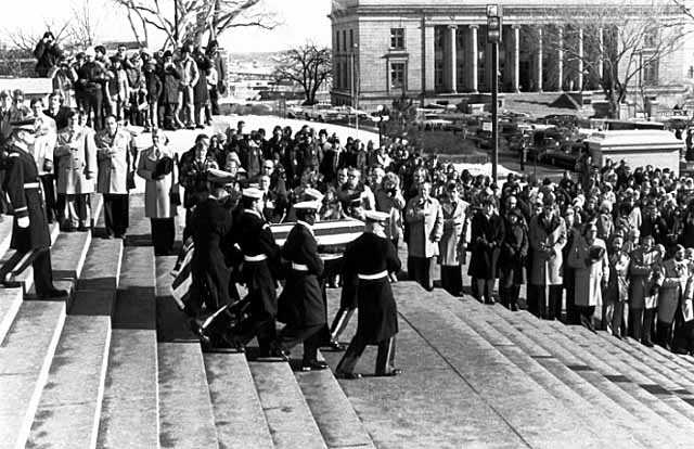 Black and white photograph of color Guard officers carrying the body of Hubert H. Humphrey down the steps of the Minnesota State Capitol in St. Paul, January 1978.
