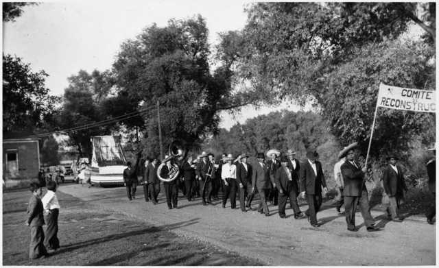 Black and white photograph of a Cinco de Mayo parade, West side, 1938.