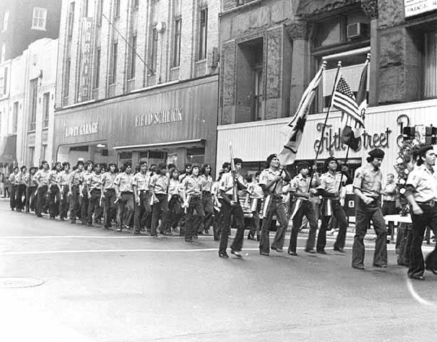 Black and white photograph of Brown Berets march in a Mexican Celebration Parade, St. Paul, September 15, 1972.