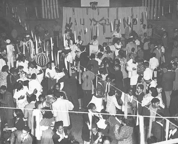 Black and white photograph of a neighborhood dance at Phyllis Wheatley House, ca. 1945.