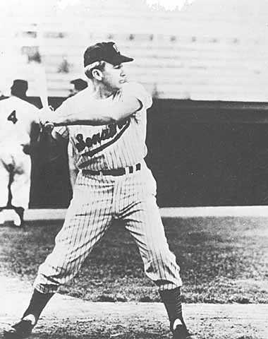 Black and white photograph of Eugene McCarthy in a Washington Senators baseball uniform, 1956.