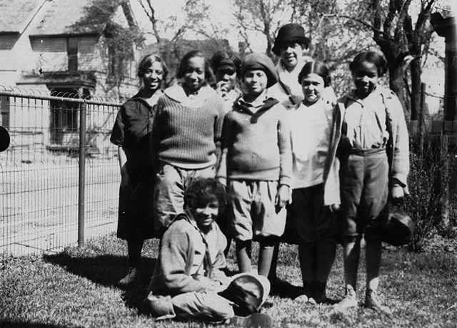 Black and white photograph of individuals starting a hike from Phyllis Wheatley House with Ethel Ray (later Ethel Ray Nance), 1926.