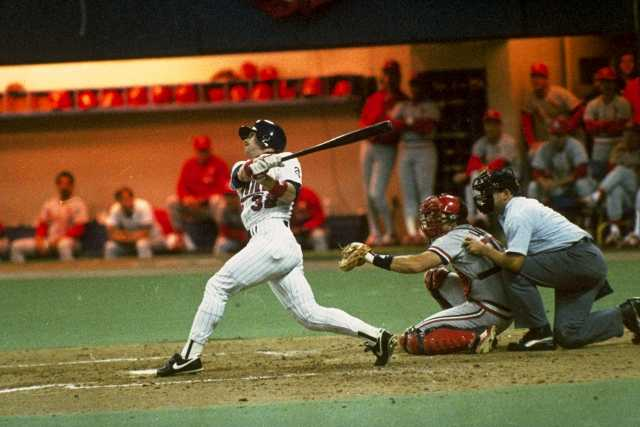 Dan Gladden connects with a fourth-inning Grand Slam in the Twins' 10-1 opening game victory.