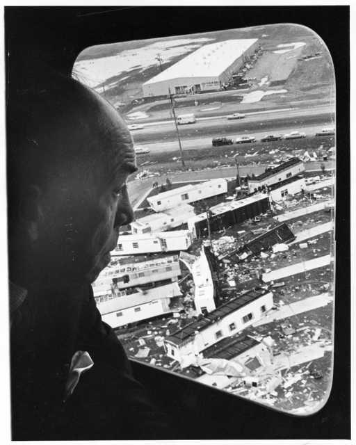 Minnesota Governor Karl Rolvaag flying over Fridley tornado wreckage