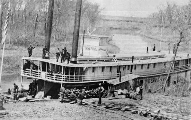 Black and white photograph of the International tied up at Moorhead,early 1870s.