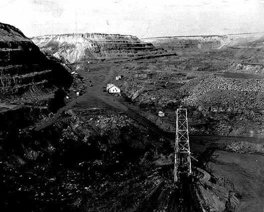 Mining at the Spruce Mine in Eveleth, ca. 1940. The Spruce Mine was one of many Oliver-controlled mines throughout the Mesabi Iron Range.