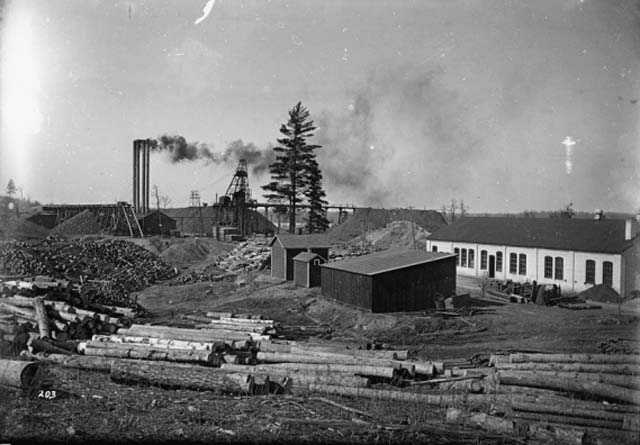 Black and white photograph of the Kennedy Mine, Cuyuna Range, c.1920. Photographed by the Aitkin Independent Age.