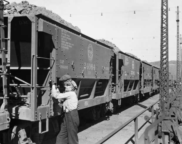 Black and white photograph of ore cars being unloaded at Dock 6 in Duluth, 1935.