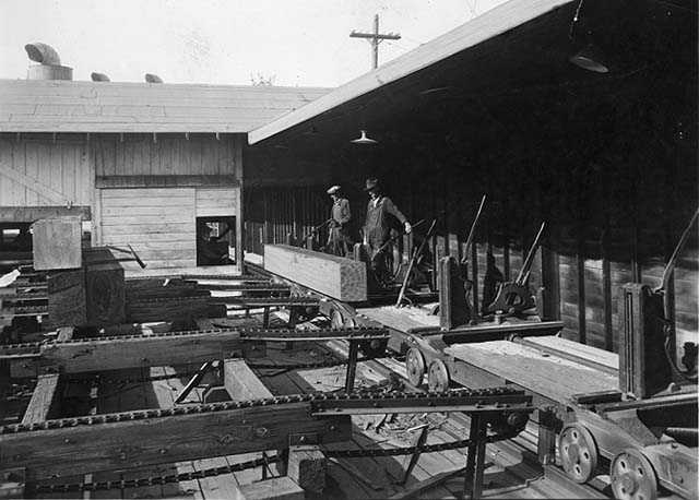 Black and white photograph of lumber milling equipment, St. Paul branch of the Weyerhaeuser Company, ca. 1935.