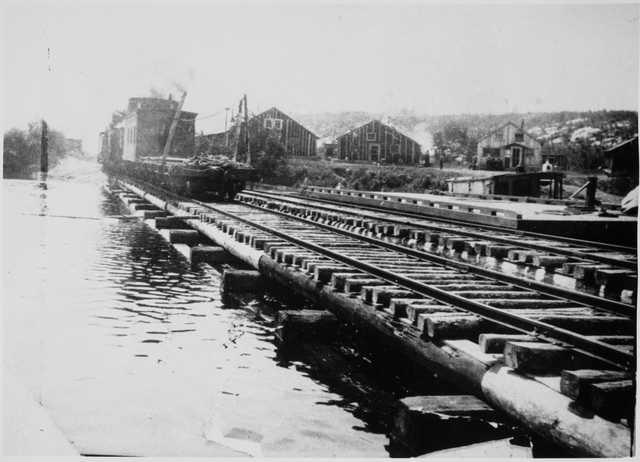Hoist Bay, Namakan Lake where the Virginia and Rainy Lake Lumber Company loaded its logs, ca. 1920.