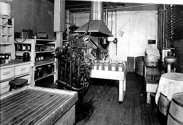 Black and white photograph of Bottling machinery at the M. A. Gedney Company, c.1912.