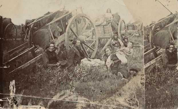 Black and white photograph of Métis drivers with Red River ox carts, probably in Minnesota, 1860.