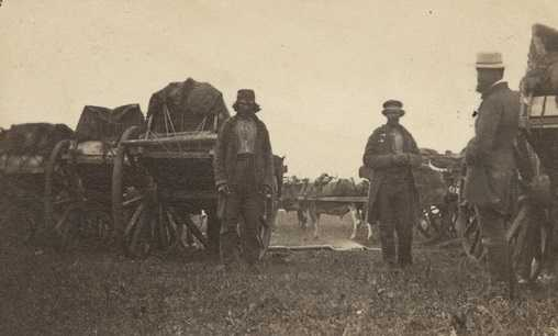 Black and white photograph of a camp with Red River carts, ca. 1860.
