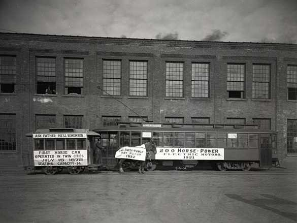 Black and white photograph of a 1872 horsecar compared to a new electric motor streetcar, May 3, 1921. Photographed by C.J. Hibbard.