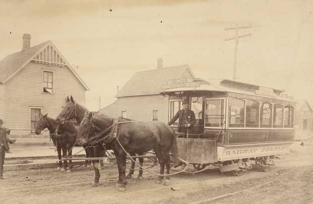 """Black and white photograph of a """"bobtail"""" horsecar 94, St. Paul City Railway Company; sign reads Rice Street to West St. Paul via Robert, Ducas, and Concord Streets, c.1883–1889."""