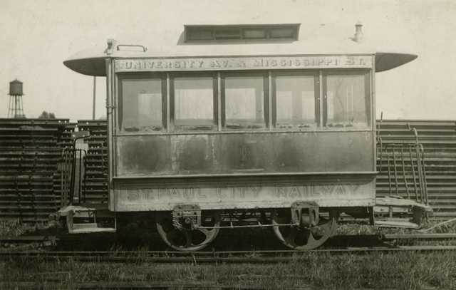 Black and white photograph of St. Paul City Railway horsecar number one at Snelling Shops storage shed prior to reconditioning for the fiftieth anniversary of the opening of the first horsecar line in St. Paul, 1922.