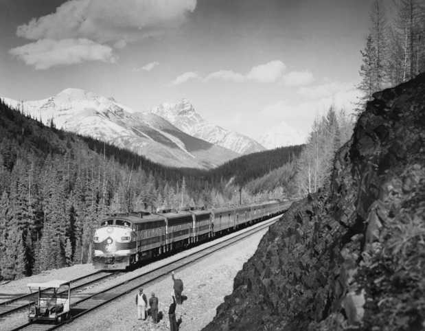 Black and white photograph of the Great Northern streamliner train in Glacier National Park, ca. 1955. Photograph by the Great Northern Railway.