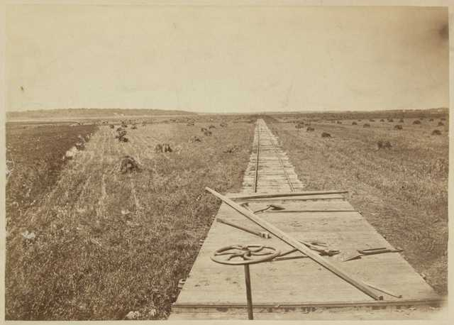 Sepia-tone photograph of railroad construction taken by Benjamin Franklin Upton, c.1868.
