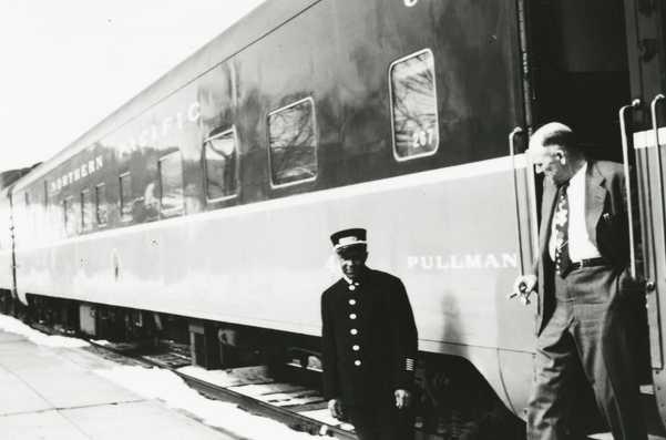 Black and white photograph of Pullman porter Dewey Jackson, c.1955.