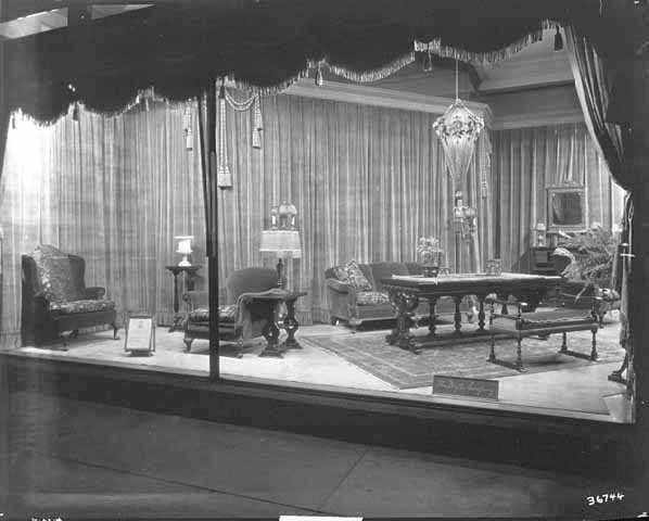 Black and white photograph of furniture window display, c.1920.