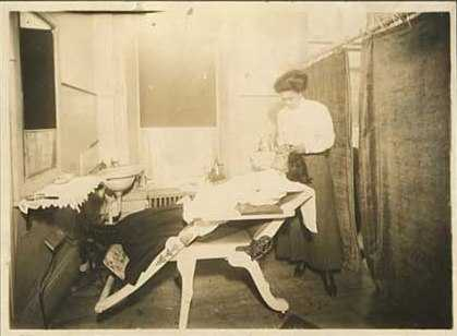 Photograph of Smith and a client at the Olive Hair Store, 1913.