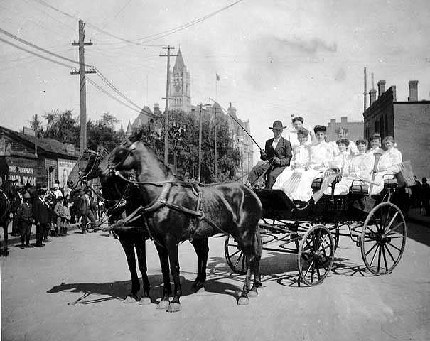United Garment Workers Union members in a horse drawn carriage on Labor Day, St. Paul, 1905.