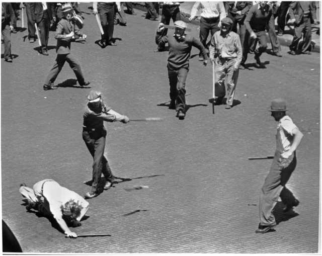Men swinging bats and sticks during clash between striking truckers and a citizens' army, Minneapolis, May 21, 1934. Pictured in the foreground are Basil Hurt, Merle Kerr, and Frank Vocks.
