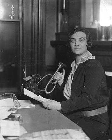 Black and white photograph of a woman in the office of the Jewish Family Welfare Association, Minneapolis, c.1925.