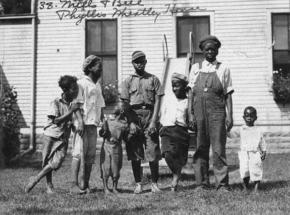 Black and white photograph of children at the Phyllis Wheatley House, 1925.