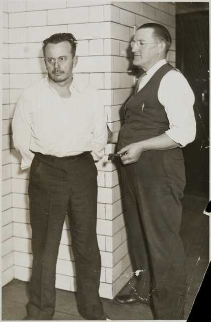"Arthur ""Doc"" Barker, left, with jailer, William Gates"