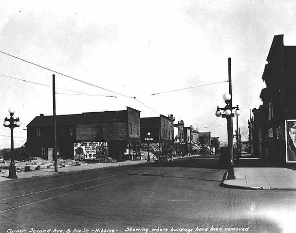 Corner Second Avenue and Pine Street, showing where buildings have been removed, Hibbing.