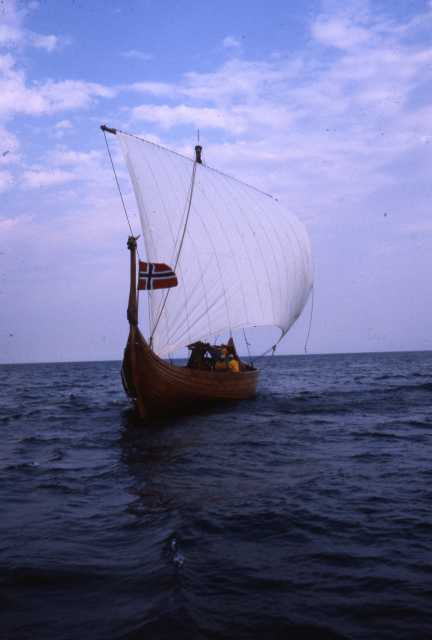 Color image of the Hjemkomst and crew on open water during their voyage to Norway, 1982. From the Tom Asp Collection, Historical and Cultural Society of Clay County.