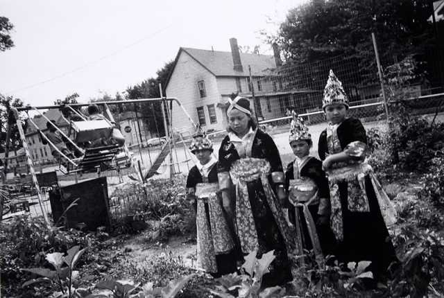 Black and white photograph of Hmong women in traditional costume, Frogtown, 1993. Photograph by Wing Young Huie.