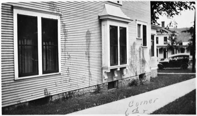 Black and white photograph of Frederick A. Scherf's home splattered with paint.