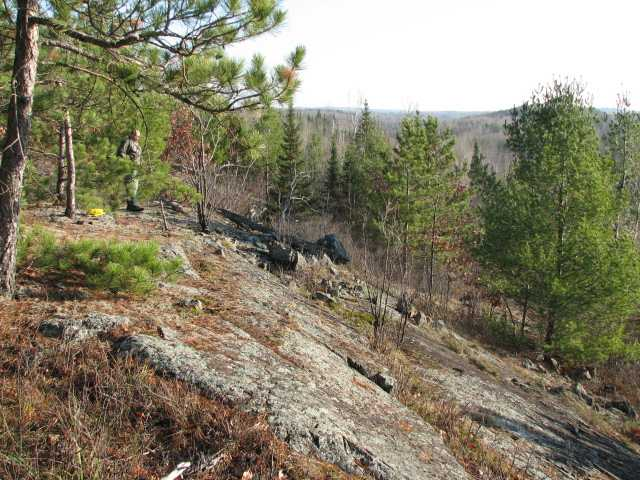 Color image of a hiker on rocky hill in Lake Vermilion–Soudan Underground Mine State Park. Photograph by Minnesota Department of Natural Resources Staff, October 30, 2007.