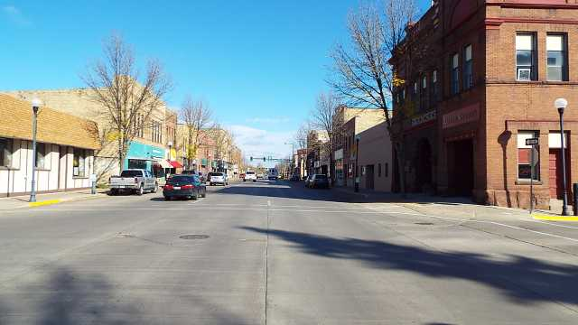 Color image of City hall at corner, looking north on Broadway, Crookston, October 2016.