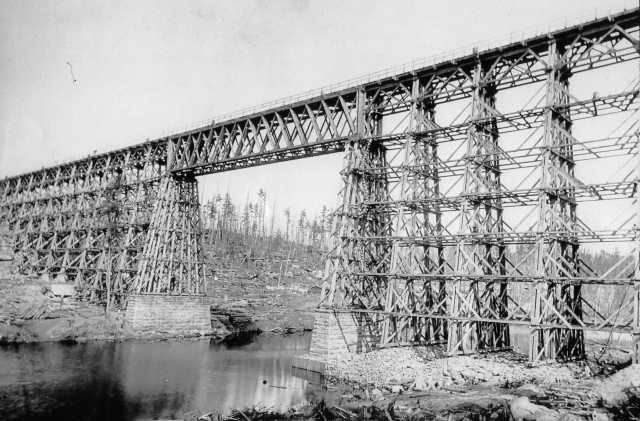 High bridge over the Kettle River near Sandstone, before September 1, 1894, and after the trees in the area were cut down by a logging company, which left highly flammable debris (slash) to serve as fire fuel. Photograph Collection, Sandstone History and Art Center, Sandstone.