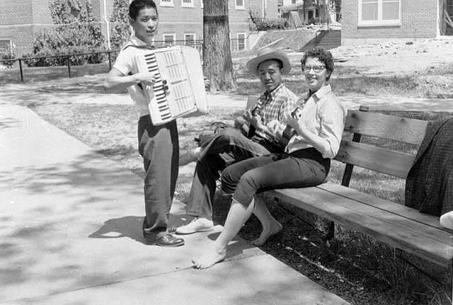 Photograph of Macalester students with accordion and ukuleles