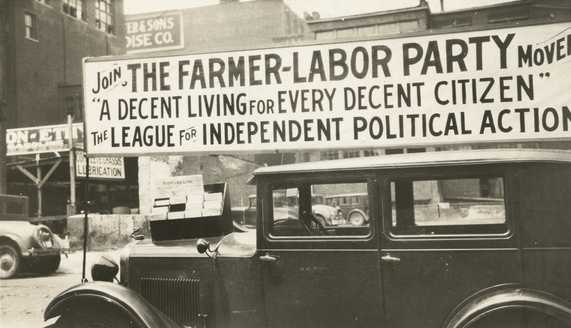 Black and white photograph of a Farmer-Labor political poster atop an automobile, c.1925.