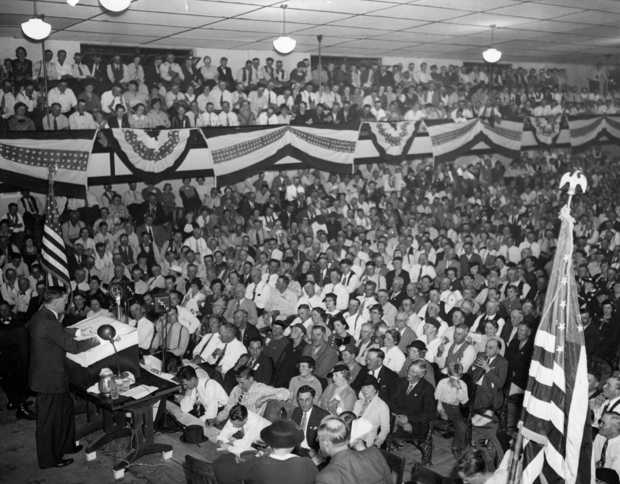 Black and white photograph of Governor Elmer Benson speaking at a Farmer-Labor state convention in Duluth, 1938.