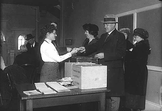 Minnesota Governor J. A. O. Preus and Idelle Preus voting, ca. 1920.